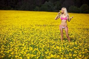Blond Woman in Pink Underwear in Field of Yellow Flowers