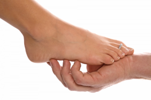 Hand Holding Foot